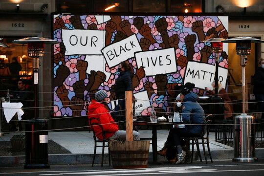 People share drinks in a local bar ahead of U.S. President-elect Joe Biden's inauguration, in Washington