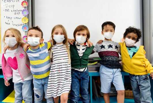 Kindergarten kids wearing masks in a classroom