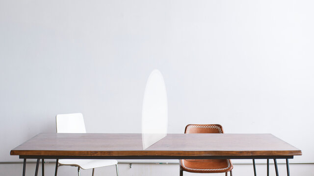 White semicircle table barrier social distancing