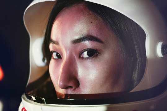 Female astronaut with glass helmet