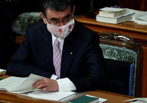 Japan's administrative and regulatory reform minister Taro Kono attends the opening of a parliament session in Tokyo