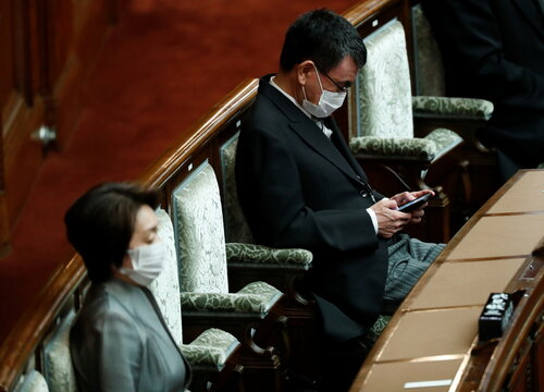 Japan's administrative and regulatory reform minister Taro Kono and Tokyo Olympics and Paralympic games Minister Seiko Hashimoto attend a parliament session in Tokyo