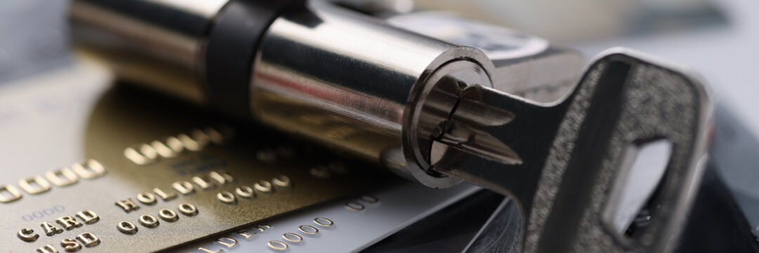 Plastic bank cards with lock with key. Security of banking system and money transfers concept