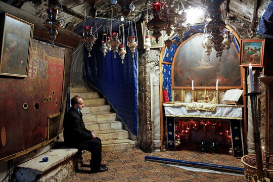 A visitor sits in the Church of the Nativity in the Palestinian town of Bethlehem in the Israeli-occupied West Bank
