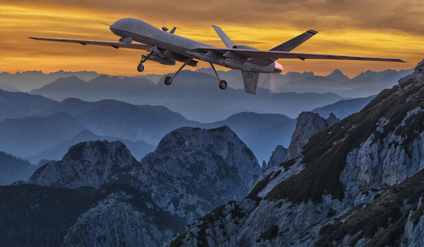 General Atomics MQ-9 Reaper drone flying over the mountains at sunset.