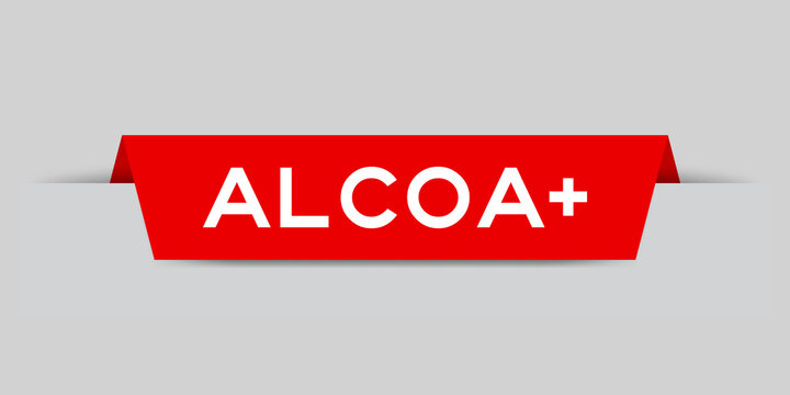 Red color inserted label with word aloca + on gray background