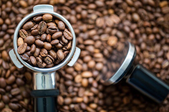 Coffee beans in a portafilter, ready to be made into a hot shot of espresso