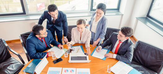 Five business people in a project meeting