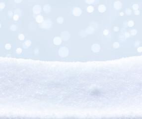 Empty winter snowy background. Defocus lights on blue background.