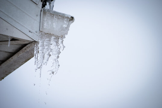 Icicles melting from roof top