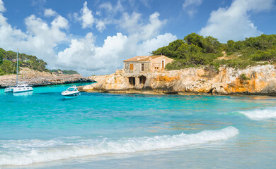Wall Mural - Landscape with old house and  turquoise sea water on Cala Mondrago, Majorca island, Spain