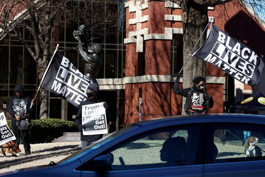 Black Lives Matter demonstrators stand on the lawn of Ebenezer Baptist Church on Martin Luther King, Jr. Day in Atlanta