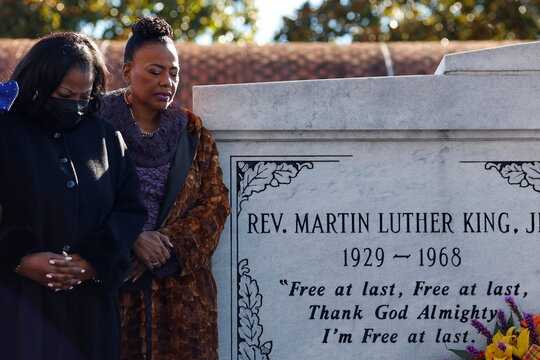 Dr. Bernice King, center, is joined by a family member as they lay a wreath at the tomb of Martin Luther King, Jr. and Coretta Scott King during Martin Luther King Jr. Day, in Atlanta