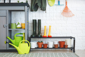 Obraz Different gardening supplies in barn - fototapety do salonu