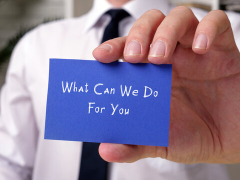 Motivational concept meaning What Can We Do For You with phrase on the piece of paper.