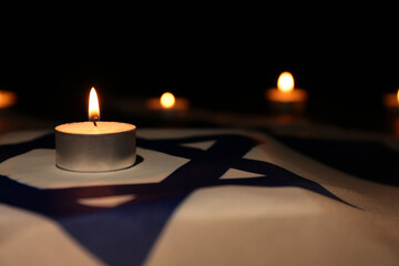 Burning candle on flag of Israel. Holocaust memory day Wall mural