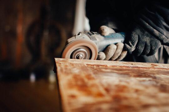 sanding wood, cleaning paint of an old vintage door, restoring antique furniture