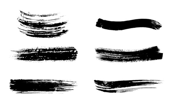 set of black ink strokes on white paper. Graphic design elements for lower third, text effect, photo pverlay, etc. Chinese style abstract brush strokes