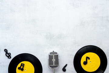 Vinyl records music background, top view