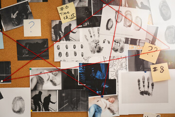 Detective board with crime scene photos, stickers, clues and red thread, closeup - fototapety na wymiar