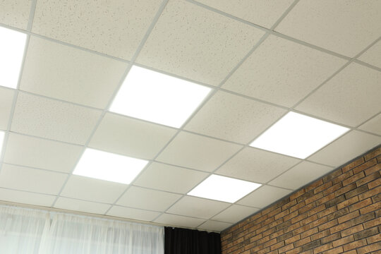 White ceiling with lighting in office room