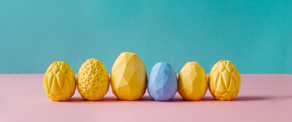 Yellow Easter eggs with geometric patterns on blue and pink background