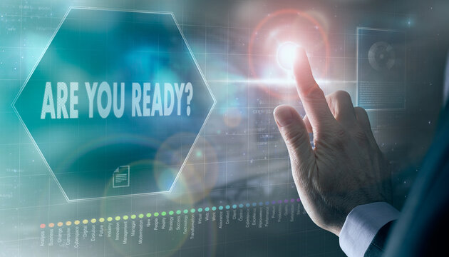 A businessman controlling a futuristic display with a Are You Ready business concept on it.