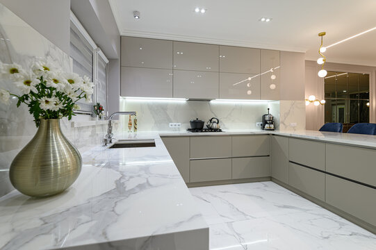 closeup to white modern marble kitchen furniture in studio space