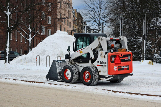 Bobcat Skid Steer Loader Snow Removal by in winter.