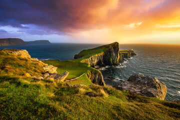 Colourful sunset at Neist Point lighthouse in Scotland. Isle of Skye.