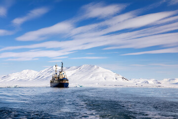 Icebreaker at anchor in the arctic waters of Svalbard, Arctic Circle