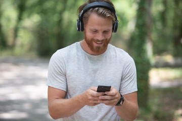 a young man in nature with headphones