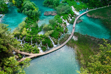Wall Mural - Top view of  Plitvice Lakes with waterfalls and wooden walkways with tourist