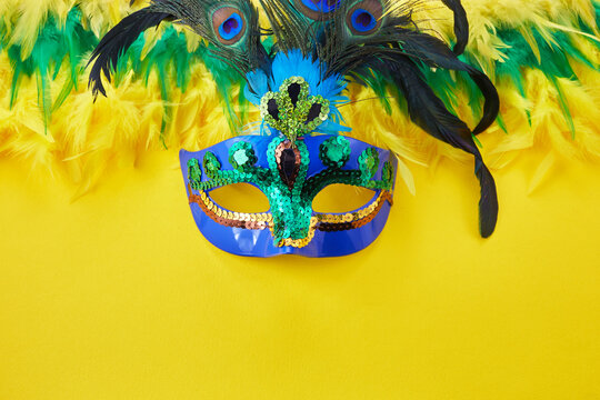 Brasil Mardi gras carnival background with multicolor feathers and mask