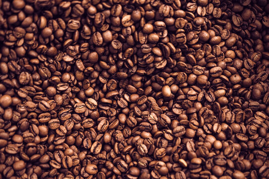 Close-up background of brown roasted coffee beans