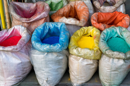 Close up colored bright color pigments in bags on street market