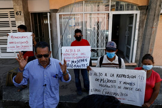 A group of Central American migrants take part in a protest against the Guatemalan government in Tapachula