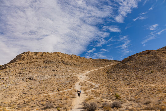 People hiking at the Lone Mountain