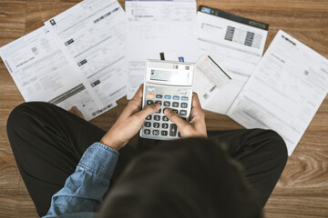 Top view man sitting on the floor stressed and confused by calculate expense from invoice or bill, have no money to pay thinking of taking the house to mortgage causing debt, bankruptcy concept. - fototapety na wymiar