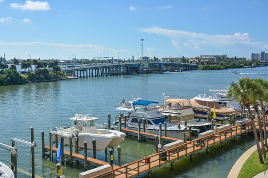 Boats parked at the dock along a waterway in St Petersburg / Clearwater in Florida
