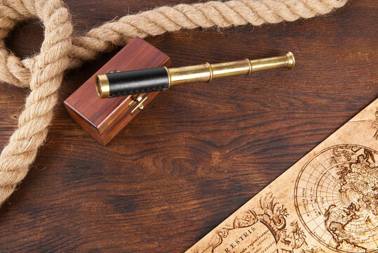 Strong Rope with Telescope on wooden Background