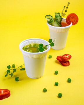 Take-out soup, vegetable soup in a glass, tomato and pea soup. Soup to go