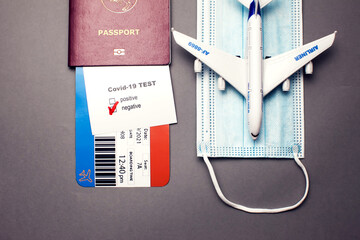 Traveling during COVID-19 virus, passport with airline ticket, covid-19 negative test, medical mask...