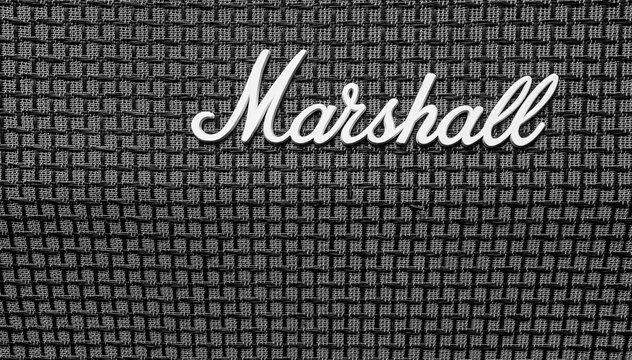 Milton Keynes, Great Britain - September 23, 2020: Closeup of Marshall logo on amplifier