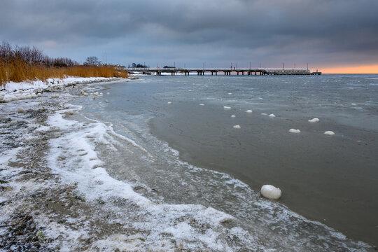 Coastline of the Hel Peninsula in winter evening scenery. Jastarnia village, Baltic Sea, Poland