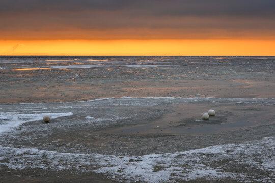 Winter landscape on the Baltic Sea. Frozen water on the beach in Jastarnia. Hel Peninsula. Poland