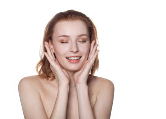 Fototapeta  beautiful redhead girl on a white background smiling