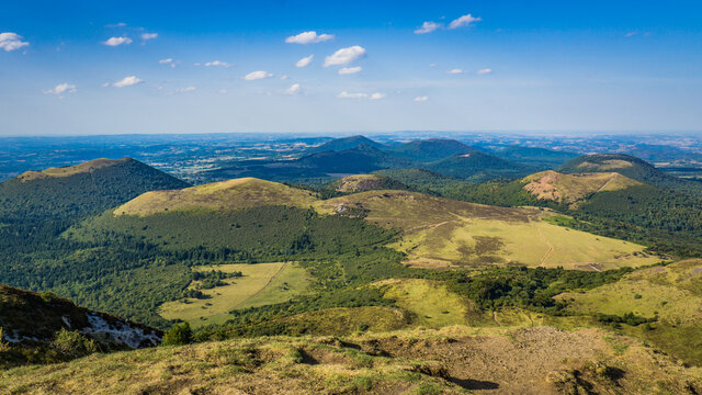 View on the Chaine des Puys volcanoes range from the top of the Puy de Dome, the most famous volcano this range, in Auvergne, France