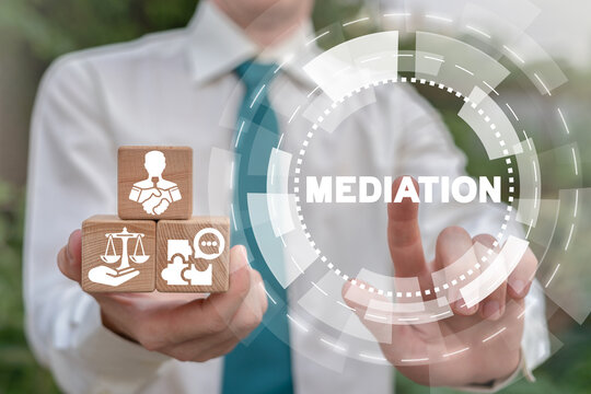 Business deal concept of mediation. Mediator hold wooden cubes with icons and click on mediation word.