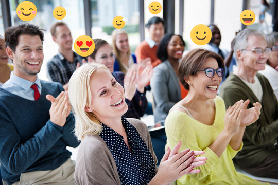 Happy business people applauding in a conference room